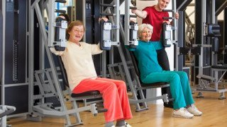 Smiling Elderly Women at the Gym with Instructor.