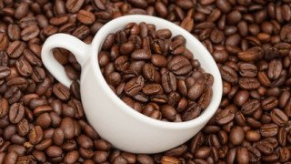 Cup full  roasted coffee beans