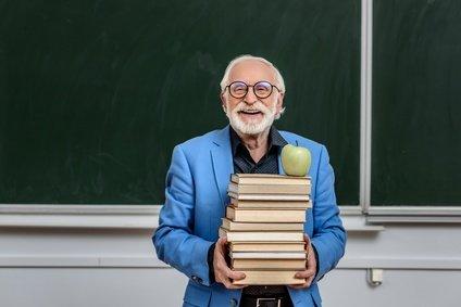 Senior confident man at school